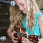 A young musician performs during a Child & Family fundraising event.