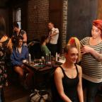 Stylists prepare models for Project Runaway.