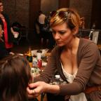 A stylist preps models for Project Runaway - a fashion show to raise funds for at-risk youth.