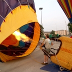 A pilot inflates the balloon in preparation for flight.